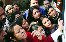 Pic courtesy Tribune - Parents jostling to scan lottery list.  (Indian Education Scene)