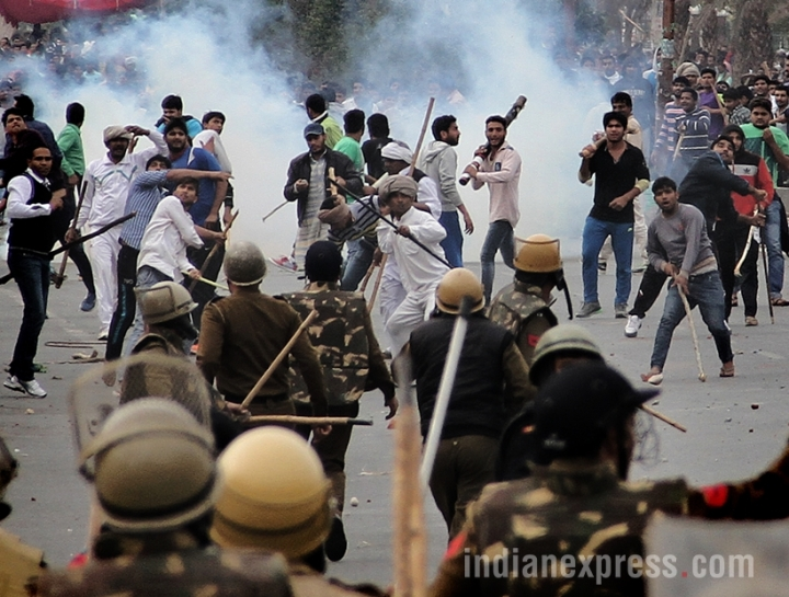 Violence exploded in Rohtak as Jat protesters demanding reservation in jobs and education. Also set fire to a minister's home, damaged property and burnt police vehicles. Mobs blocked highways and rail tracks. EXPRESS PHOTO BY GAJENDRA YADAV 19 02 2016.